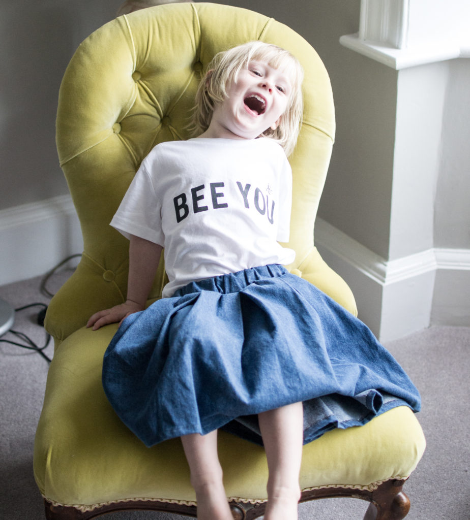 Daisy wearing Bee You T Shirt by Deborah Campbell Atelier