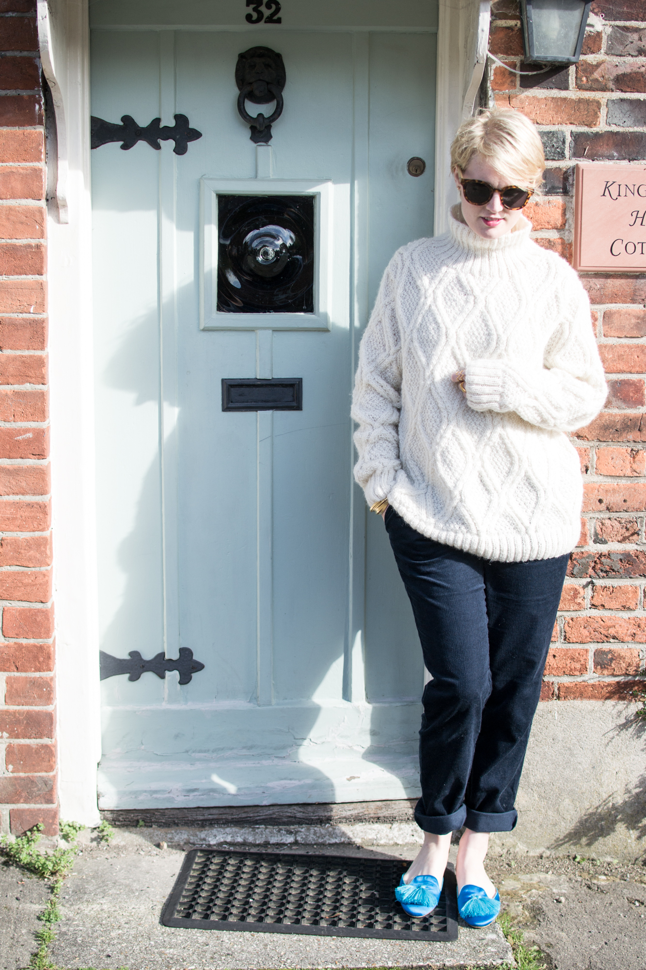 Cream Cable Knit Jumper and navy corduroy trousers People Tree