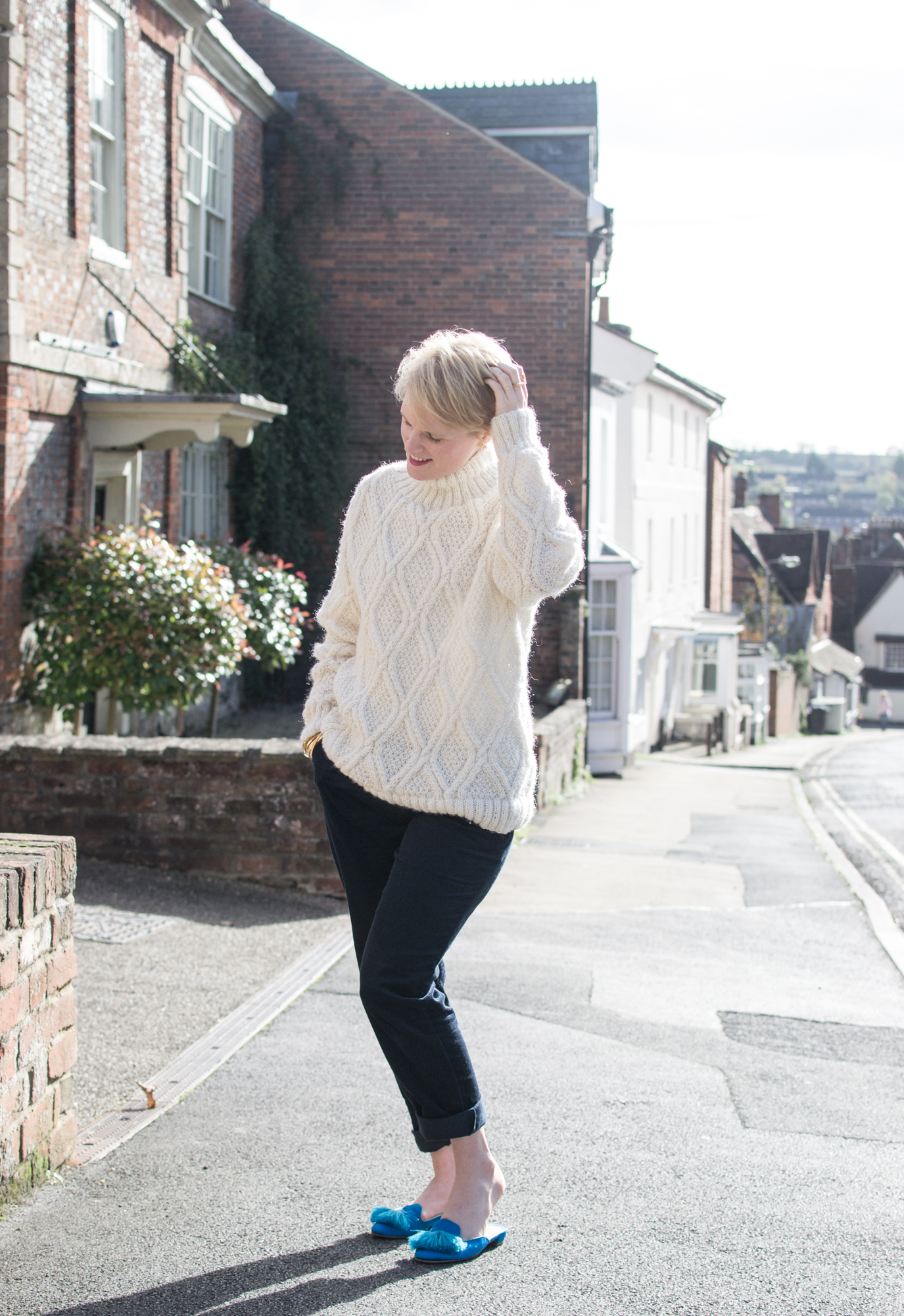 Cream Cable Knit Jumper and navy corduroy trousers from People Tree