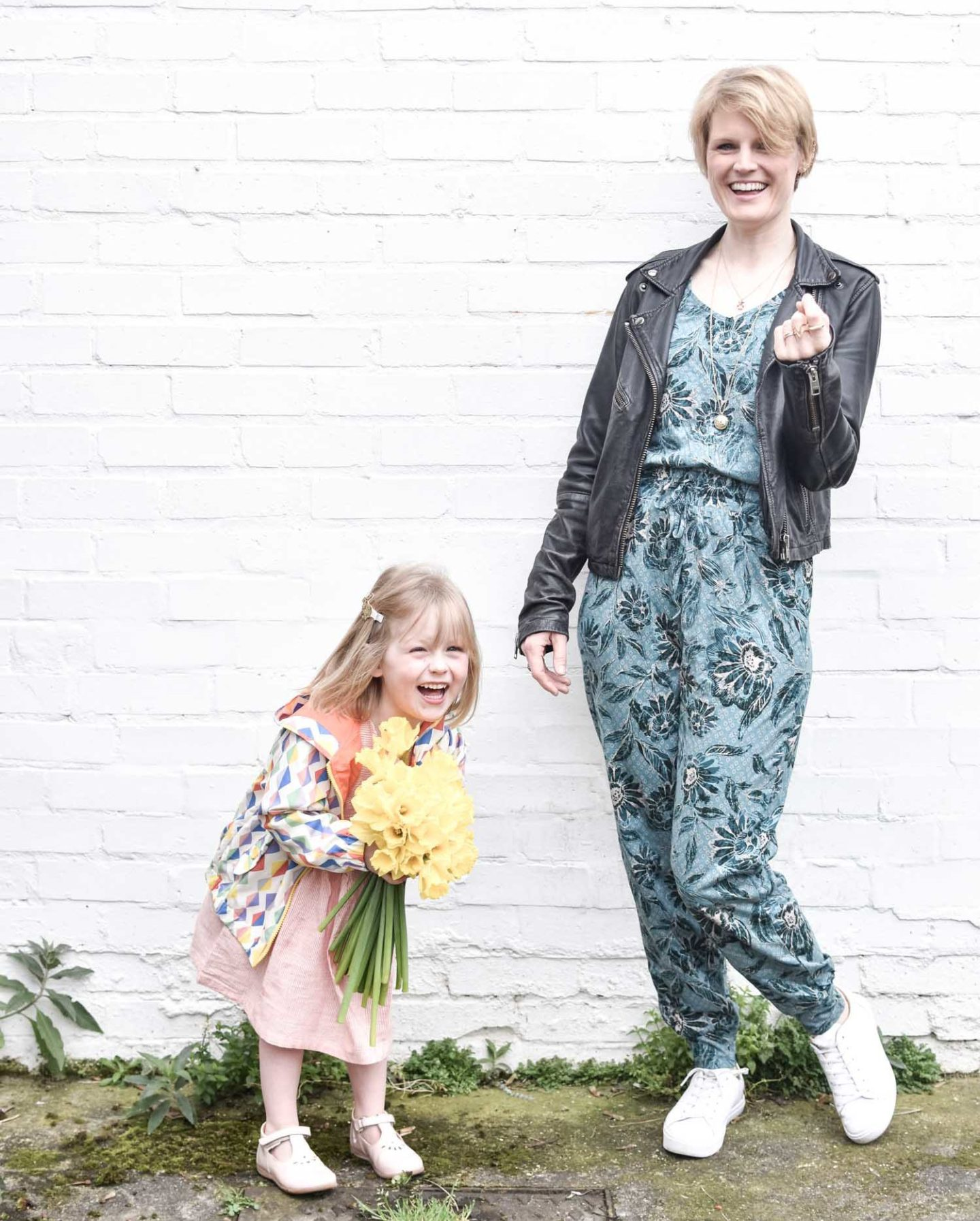 e58278ce9f3 Sustainable Style Blogger Karen Maurice of n4mummy wearing Thoughts floral  jumpsuit with a black leather jacket