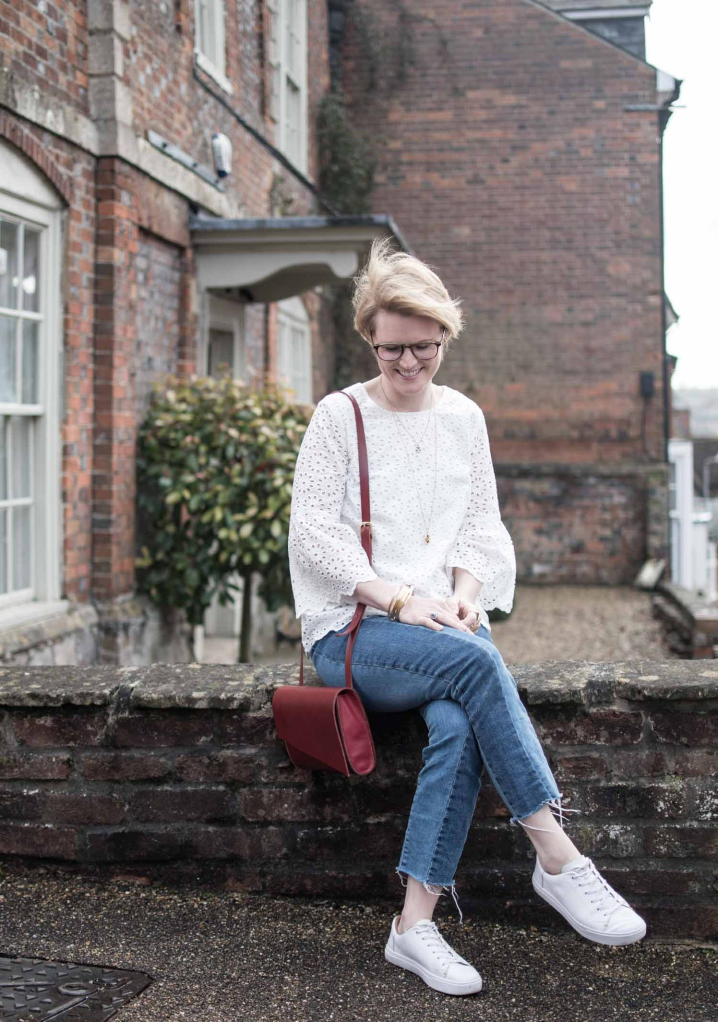 75f03d2394a Sustainable Style Blogger Karen Maurice of n4mummy wearing Thoughts White  embroidered top styled with jeans and ...